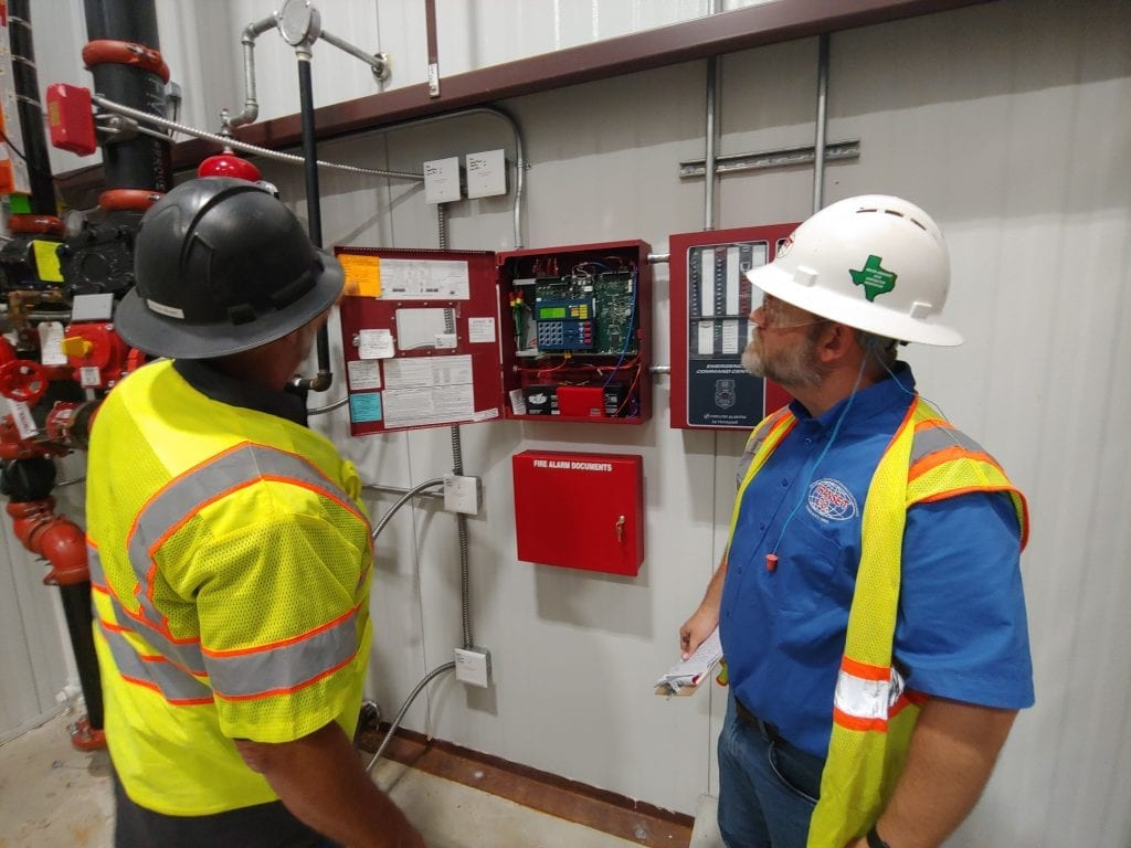 employees reviewing alarm